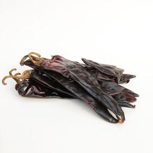 Whole dried Guajillo chilli